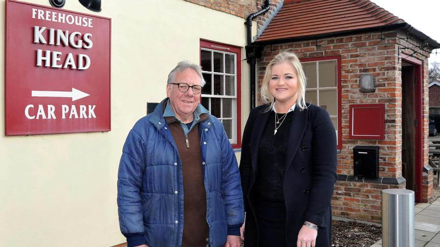 Owner of the King's Head David Bower with Banks Long & Co Surveyor Harriet Hatcher outside the premises