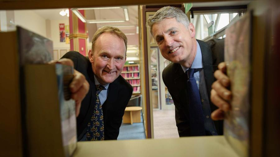 Cllr Nick Worth, Executive Member for Libraries (L) with Peter Bundey, Deputy Managing Director for GLL. Photo: Steve Smailes for The Lincolnite