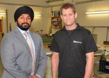 Banks Long & Co Surveyor Jag Landa with cabinetmaker Michael Warrington in Michael's new workshop