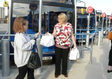 Managing Director Michelle Hargreaves handing out breakfast bags to loyal customers.