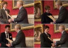 The UTC boys collecting their Duke of York awards.