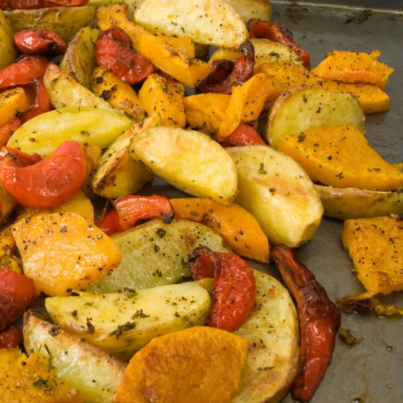 Roasted fall vegetables fresh from the oven 2 Roasted Fall Vegetable Salad with Warm Goat Cheese & Honey Mustard Vinaigrette