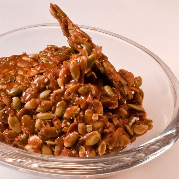 Bowl of carmelized pumpkin seeds Caramelized Ancho Chile & Cinnamon Almonds
