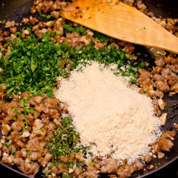 Combining Sauteed Sausage Fresh Herbs Parmesan and Bread Crumbs for Stuffed Mushrooms Spicy Sausage & Fresh Herb Stuffed Crimini Mushrooms