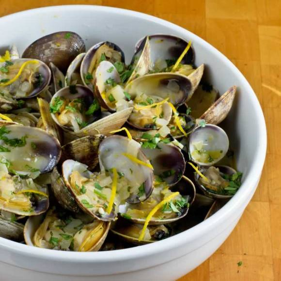 Hood Canal Manila Clams with Spicy Orange Cilantro Butter in a Bowl Hood Canal Manila Clams with Spicy Orange Cilantro Butter
