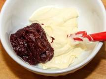 Combining Spiced Cranberry Sauce and Cheesecake Batter.