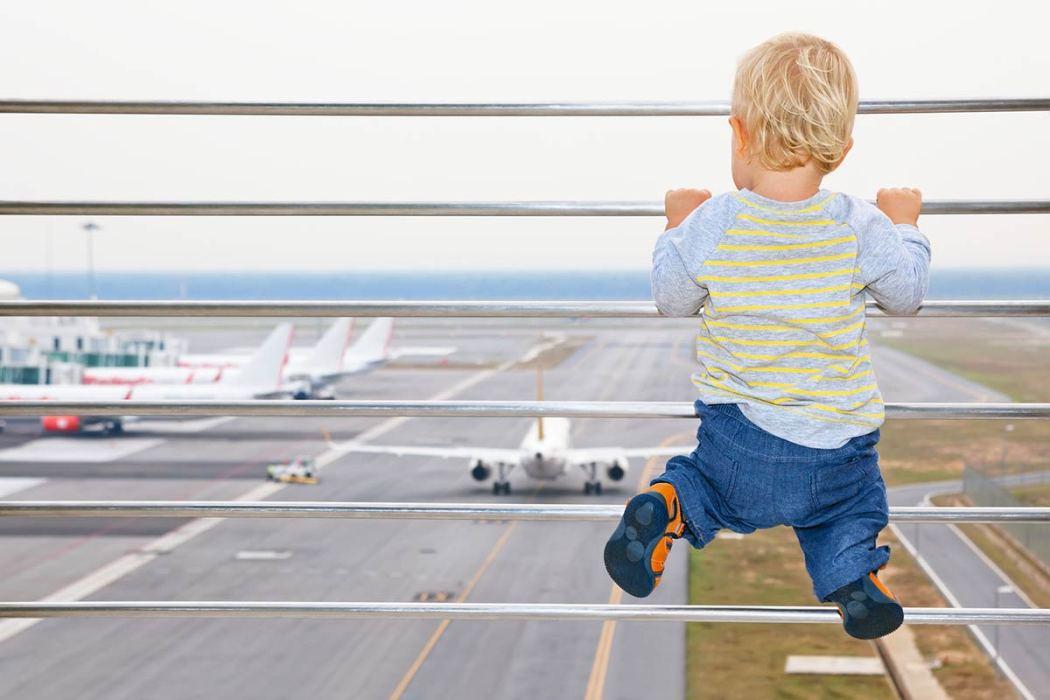 bigstock-Baby-Boy-In-Airport-Transit-Ha-109670942