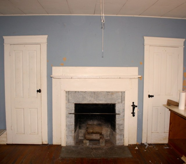 The Hearth Room has an old soapstone fireplace and peeling paint