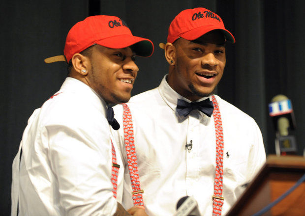 Grayson (Ga.) High defensive end Robert Nkemdiche, right, the nation's top recruit, is congratulated by his brother Denzel during Robert Nkemdiche's announcement to play college football for Ole Miss during a signing ceremony Wednesday, Feb. 6, 2013. (David Tulis/AP Photo)