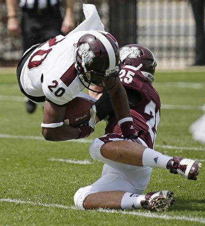 Mississippi State White running back Trey Braswell (20) is upended for a loss by a low tackle by Mississippi State Maroon defensive back Jahmere Irvin-Sills (25) during the second half of their spring NCAA college football game, Saturday, April 12, 2014, in Starkville, Miss. Maroon won 41-38. (AP Photo/Rogelio V. Solis)