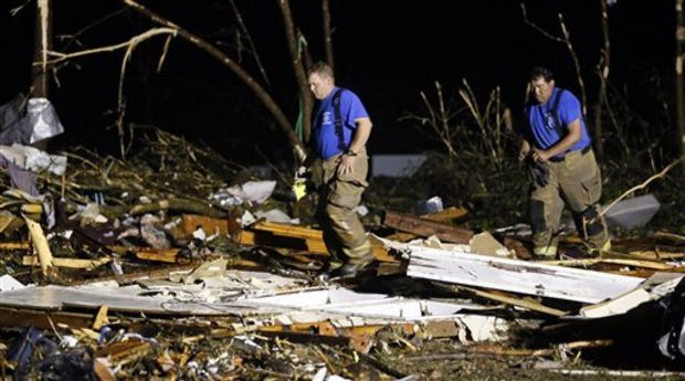 Emergency personnel search the remains of several mobile homes for survivors in Louisville, Miss., early Tuesday morning, April 29, 2014 after a tornado hit the east Mississippi community Monday. Tornadoes flattened homes and businesses, flipped trucks over on highways and bent telephone poles into 45-degree angles as they barreled through Alabama and Mississippi on Monday, part of a storm system that killed at least nine people in the South and brought the overall death toll from two days of severe weather in the country to at least 26. (AP Photo/Rogelio V. Solis) (Rogelio V. Solis)
