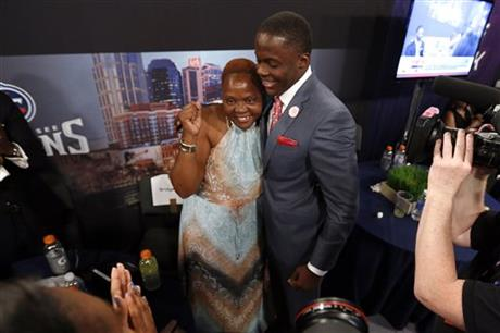 Teddy Bridgewater, from Louisville, embraces his mother Rose Murphy after being selected 32nd overall by the Minnesota Vikings in the first round of the NFL football draft, Thursday, May 8, 2014, at Radio City Music Hall in New York. (AP Photo/Jason DeCrow)