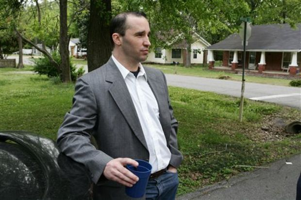 In this Tuesday April 23, 2013, file photo, James Everett Dutschke stands in the street near his home in Tupelo, Miss. A federal judge has set a May 14 sentencing date for Dutschke. The 42-year-old Tupelo man pleaded guilty in January to charges of making ricin and sending letters dusted with the poison to President Barack Obama, Republican U.S. Sen. Roger Wicker and Mississippi judge Sadie Holland. Dutschke will be sentenced by U.S. District Judge Sharion Aycock in Aberdeen. (AP Photo/Northeast Mississippi Daily Journal, Thomas Wells, File)