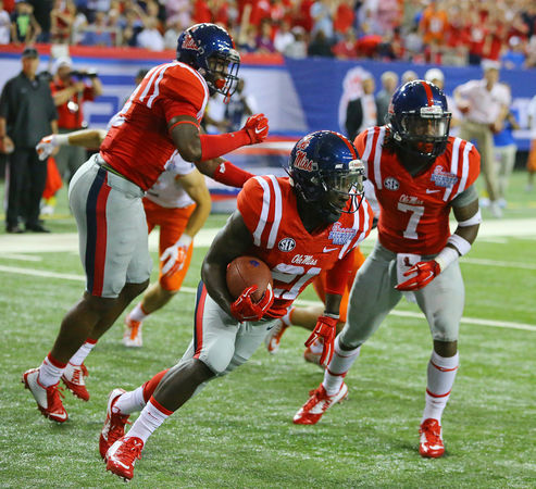 Mississippi defensive back Senquez Golson intercepts Boise State in the end zone during the first quarter of an NCAA college football game, Thursday, Aug. 28, 2014 in Atlanta. (AP Photo/Atlanta Journal-Constitution, Curtis Compton)