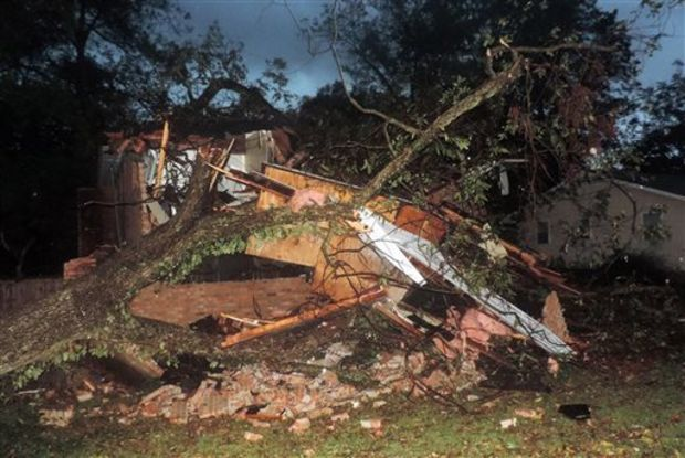 Heavy wind, rain and hail brought a tree down on the Louisville Street Apartments in Starkville, Miss., Monday night, Oct. 13, 2014. None of the residents were injured. Strong winds played havoc with power lines, trees and signage. (AP Photo/The Starkville Daily News, Steven Nalley)