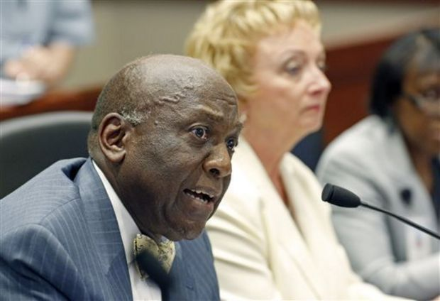 Mississippi Department of Education board chairman John Kelly, left, opens the department's presentation before the Joint Legislative Budget Committee in Jackson, Miss., Tuesday, Sept. 30, 2014, as State Superintendent Carey Wright listens. Wright and other officials made their legally-mandated push for support of Mississippi's school funding formula during their budget presentation. (AP Photo/Rogelio V. Solis)