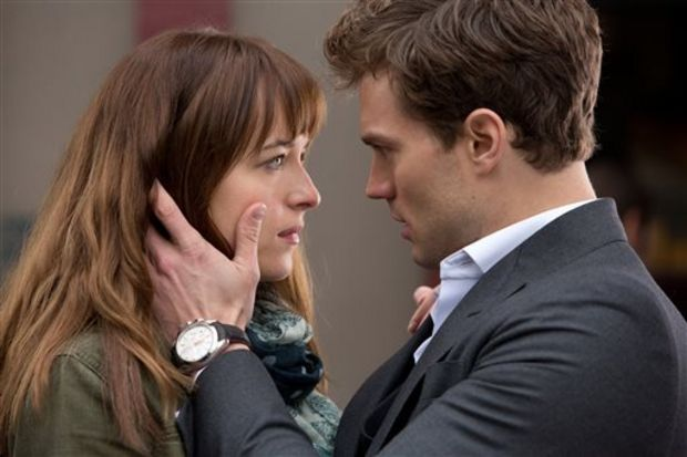 "In this image released by Universal Pictures and Focus Features, Dakota Johnson, left, and Jamie Dornan appear in a scene from ""Fifty Shades of Grey."" (AP Photo/Universal Pictures and Focus Features)"