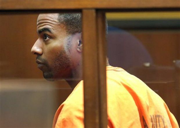 In this April 18, 2014 file photo, former NFL football All-Pro safety Darren Sharper appears in Superior Court in Los Angeles. Rape charges have been filed in Las Vegas against former NFL safety Darren Sharper, who already faces sexual assault charges in Los Angeles, New Orleans and the Phoenix area. Sharper's Las Vegas attorney, David Chesnoff, appeared Friday, March 20, 2015, before a Las Vegas judge on two sexual assault charges involving two women in January 2014. (AP Photo/Nick Ut, File)