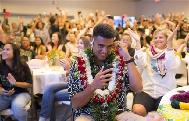 Former Oregon quarterback Marcus Mariota reacts to being drafted by the Tennessee Titans with the second pick in the first round on NFL Draft Day Thursday, April 30, 2015, in Honolulu. (Thomas Boyd/The Oregonian via AP, Pool)