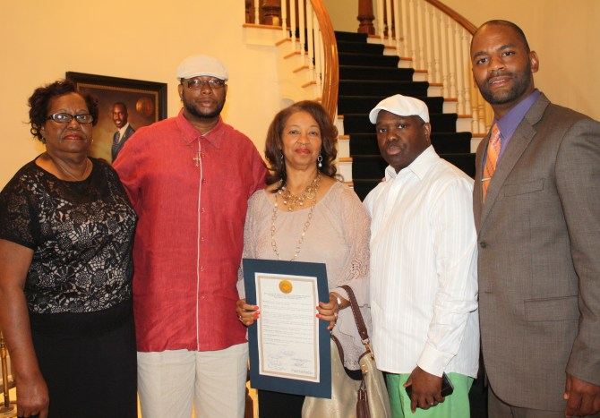 James Craig Anderson's family members at the City Council meeting holds resolution honoring his memory: Doris Trimble, James Bradfield, Barbara Anderson Young and Grayon Winford, joined by Council President De'Keither Stamps who presented the resolution. PHOTO BY AYESHA K. MUSTAFAA