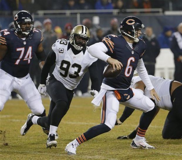 In this Dec. 15, 2014 file photo, New Orleans Saints outside linebacker Junior Galette (93) chases Chicago Bears quarterback Jay Cutler (6) before a sack during the first half of an NFL football game in Chicago. Galette agreed to a one-year contract with the Washington Redskins for the league minimum on Friday, according to agent Alvin Keels. (Charles Rex Arbogast/The Associated Press)