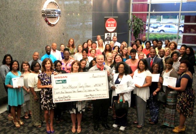 Mini grant recipients with Nissan Canton vice president of Manufacturing Steve Marsh (front center)