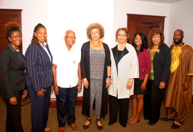 Dr. Daphne R. Chamberlain, chair of Tougaloo's Dept of History and Political Science; Dr. S. Nicole Cathey, Assistant professor of political science; Hollis Watkins Muhammad, chair of the Veterans of the Mississippi Civil Rights Movement Inc.; Professor Angela Davis; Tougaloo President Beverly W. Hogan; Jarmyra Davis, Tougaloo Chapter MS NAACP 2015-2016; Cynthia Goodloe Palmer, executive director of VMCRM; and Dr. Michael Williams, dean of Tougaloo's Division of Social Sciences. PHOTO BY JAY JOHNSON
