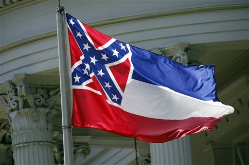 In this photo taken June 23, 2015, the Mississippi state flag is unfurled against the front of the Governor's Mansion in Jackson, Miss. A new proposal seeks a statewide election on removing the Confederate battle emblem from the Mississippi flag. But it could be years before the issue gets on the ballot, and there's no guarantee voters would accept it.(AP Photo/Rogelio V. Solis)