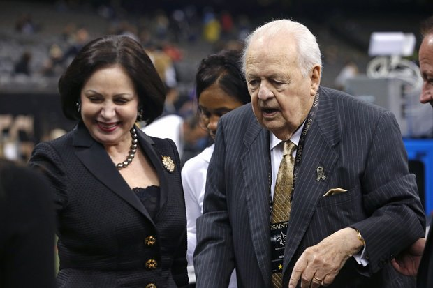 New Orleans Saints owner Tom Benson walks with his wife Gayle Benson before an NFL football game against the Tennessee Titans in New Orleans, Sunday, Nov. 8, 2015. (Jonathan Bachman/AP Photo)