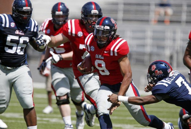 Former Ole Miss quarterback Maikhail Miller (9) has died in a one-car accident in Marshall County. AP file photo