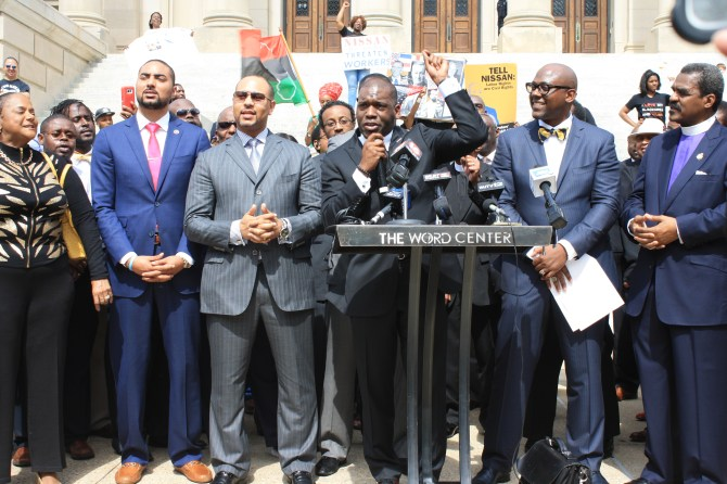 Pastor Jamal Bryant leads a chant to bring down the state flag. PHOTO BY SHANDERIA K. POSEY