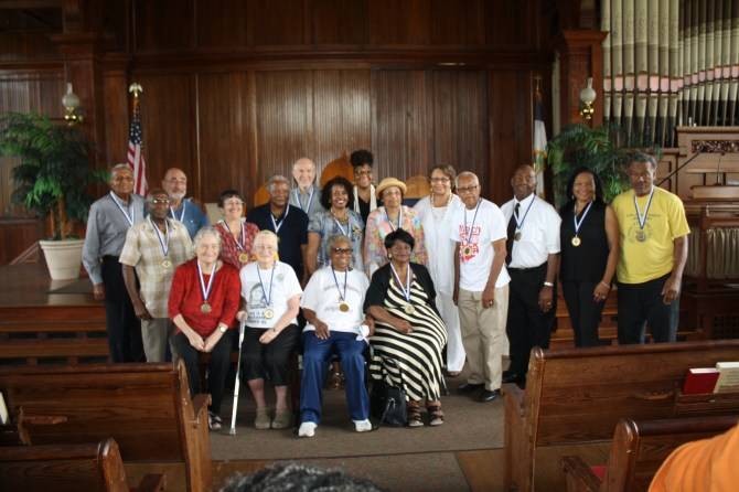 Honored 1966 marchers who attended the program at Tougaloo College were (front row, from left) Harriet Tanzman, Joan Trumpauer Mulholland, Annie Pearl Avery, Dorothy Benford; (second row)  Bobby Talbert, Marilyn Loewen, Charles McLaurin, unidentified, Flonzie Brown Wright, Beverly Wade Hogan, president of Tougaloo College; Hollis Watkins, Robert Smith, Roslyn McCoy, MacArthur Cotton; (third row) Wendell Paris, unidentified, Dick Johnson and Pam Confer, of Nissan. PHOTO BY SHANDERIA K. POSEY