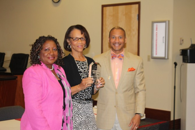 The Mississippi Link Publisher Jackie Hampton (center) accepts the Superintendent's Bowtie Plaque award from Cedrick Gray, JPS superintendent and Beneta Burt, JPS School Board president, June 2. PHOTO BY DIAMOND WILLIAMS