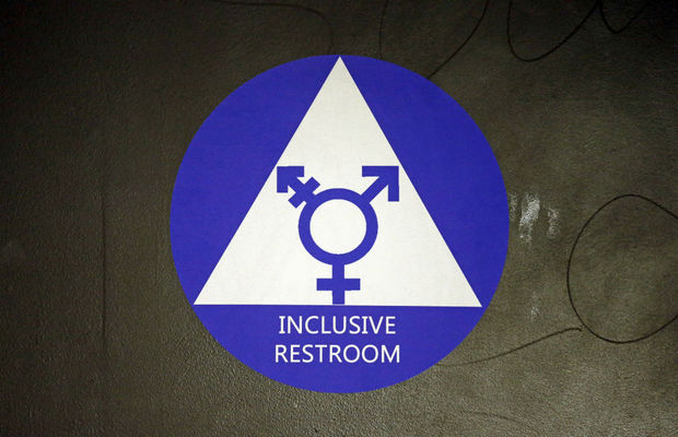 In this May 17, 2016, file photo, a new sticker designates a gender neutral bathroom at Nathan Hale high school in Seattle. A Virginia school board urged the U.S. Supreme Court on Monday to weigh in on whether a transgender male must be allowed to use the boys bathroom at his high school, framing it as an issue of national importance. (AP Photo/Elaine Thompson, File)