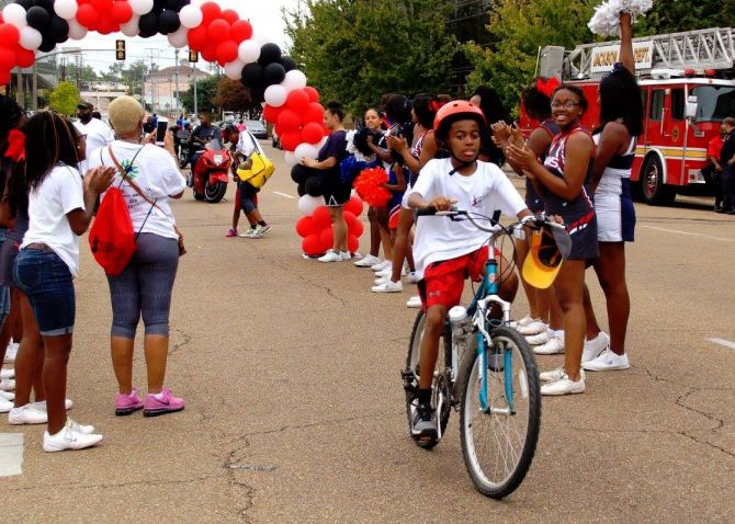 Jaden Nixon rides his way to the end of the Cure Sickle Cell Foundation's 5K Walk, Run and Ride at last year's event. PHOTO FROM FACEBOOK