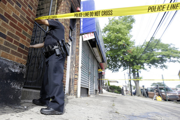 A narrative of the incident provided with Wednesday's statement says Gaines, who was black, was fatally shot on Aug. 1 after she barricaded herself inside her apartment and pointed a shotgun at officers attempting to serve an arrest warrant. (Julio Cortez / AP)