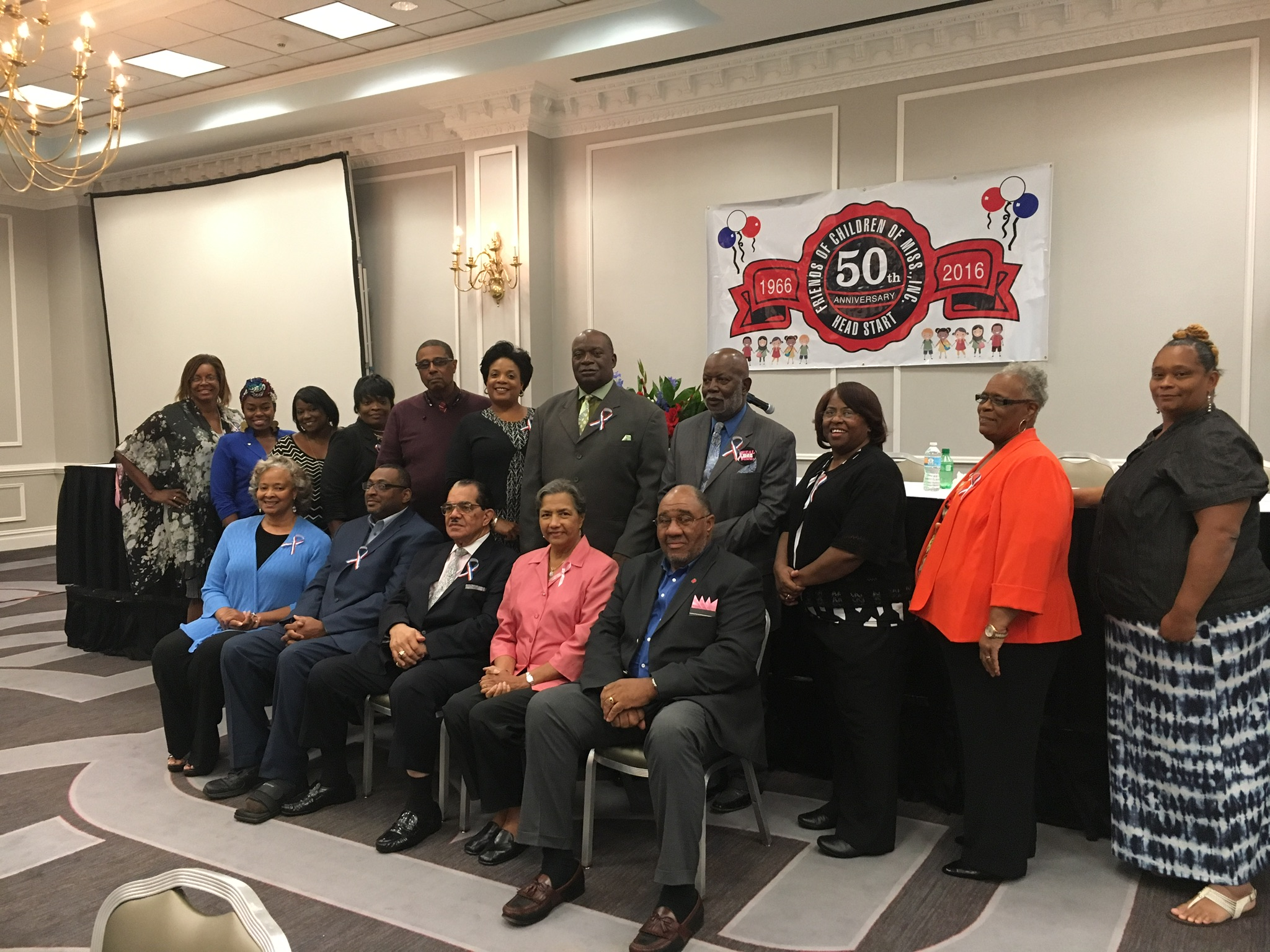 Friends of Children, Inc. current and former board members stand as policy council members sit for a group photo.