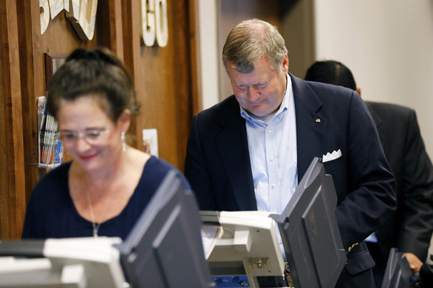 State Supreme Court candidate Kenny Griffis, right, and his wife Mary Helen, vote on a variety of offices including president at their Ridgeland, Miss., precinct, on Tuesday, Nov. 8, 2016. (AP Photo/Rogelio V. Solis) (Rogelio V. Solis)