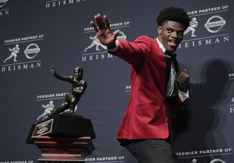 In this Dec. 10, 2016, file photo, Louisville's Lamar Jackson poses with the Heisman Trophy after winning the Heisman Trophy award in New York. Jackson was selected to the 2016 AP All-America college football team, Monday, Dec. 12, 2016. (AP Photo/Julie Jacobson, File)