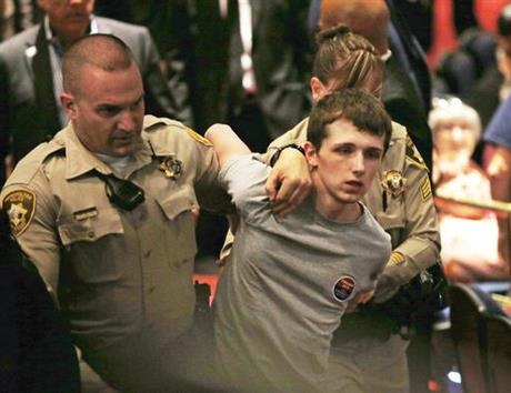 In this June 18, 2016 file photo, police remove Michael Steven Sandford as Republican presidential candidate Donald Trump speaks at the Treasure Island hotel and casino in Las Vegas. On Tuesday, Dec. 13, 2016, the British man diagnosed with mental illness was sentenced to about four more months in a U.S. prison for trying to grab a police officer's gun in a plan to kill Trump at a campaign rally last June in Las Vegas. (AP Photo/John Locher, File)