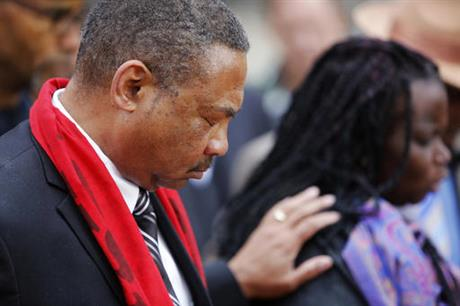 Pastor Thomas Dixon, left, prays during a prayer vigil in front of the Charleston County Courthouse as the jury deliberates in the Michael Slager trial Monday, Dec. 5, 2016, in Charleston, S.C. Slager, the former North Charleston police officer is charged with murder in the shooting death last year of Walter Scott. (AP Photo/Mic Smith)