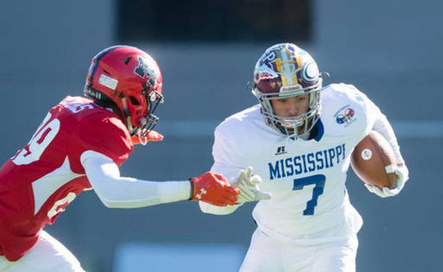 Mississippi All Star Tyrese Fryfogle of George County runs downfield as Alabama All Star Jordyn Peters of Muscle Shoals moves in to tackle him during the Alabama vs. Mississippi All-Star high school football game at the Cramton Bowl in Montgomery, Ala., on Saturday, Dec. 10, 2016. The Montgomery Advertiser via AP Albert Cesare