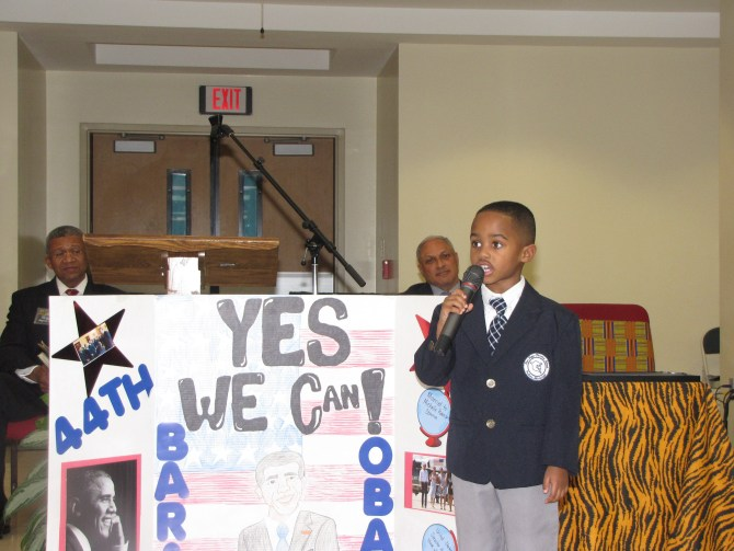 "New Hope Christian School boy reminds audience of President Barack Obama's ""Yes We Can"" appeal for a better America."
