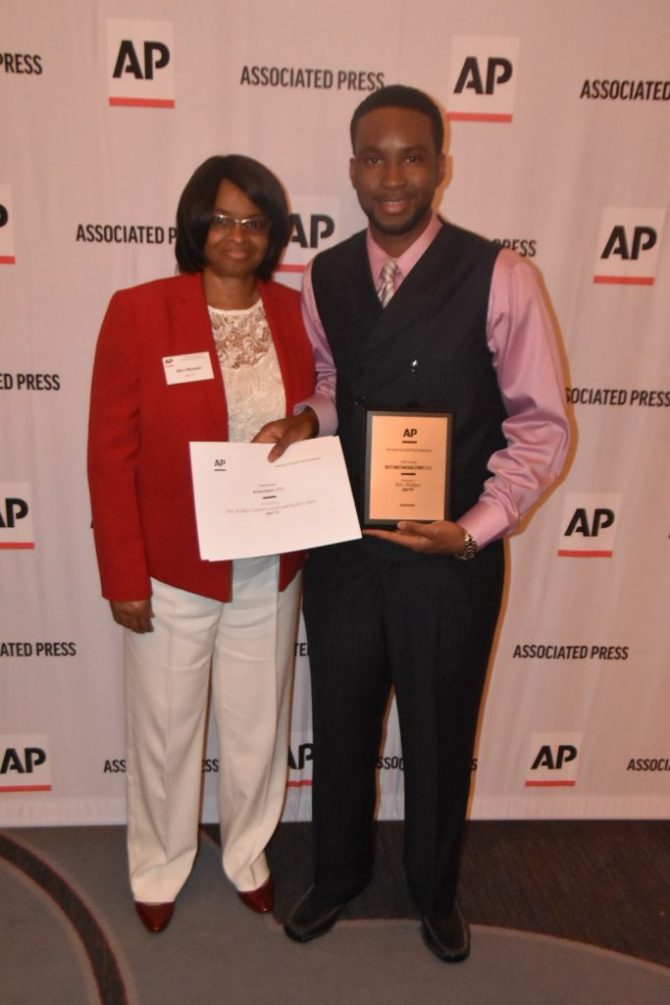 Eric Walker and mother Mira Massey, who traveled from Augusta, Ga. to attend the AP journalism honor awards program. PHOTO BY KEVIN BRADLEY