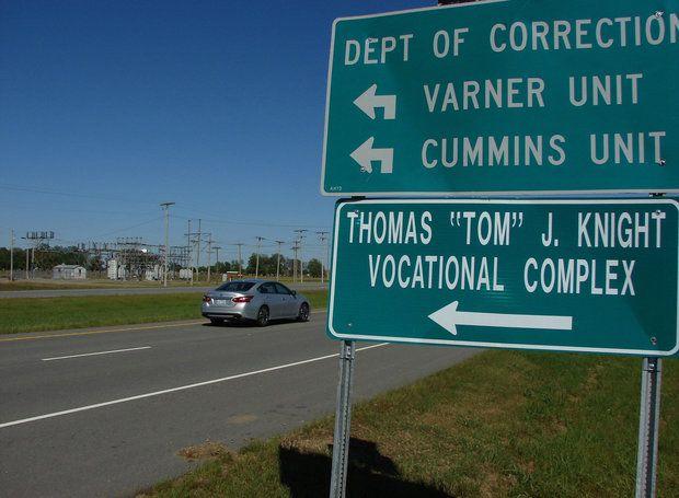 A motorist passes by the entrance to the Cummins Unit prison near Varner, Ark., on Thursday, April 27, 2017. (AP Photo/Kelly P. Kissel)