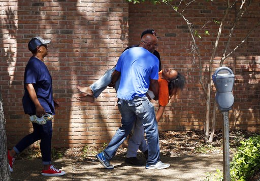 Family members carry a grief stricken Ebony Archie, mother of Kingston Frazier, after learning the young boy was found dead after being kidnapped during the theft of his mother's vehicle from a Kroger parking lot, Thursday, May 18, 2017, in Jackson, Miss. (Elijah Baylis/The Clarion-Ledger via AP)