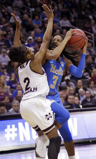 UCLA guard Jordin Canada (3) shoots while covered by Mississippi State guard Morgan William (2) during the first half of a women's NCAA college basketball tournament regional final game, Sunday, March 25, 2018, in Kansas City, Mo. (AP Photo/Orlin Wagner)