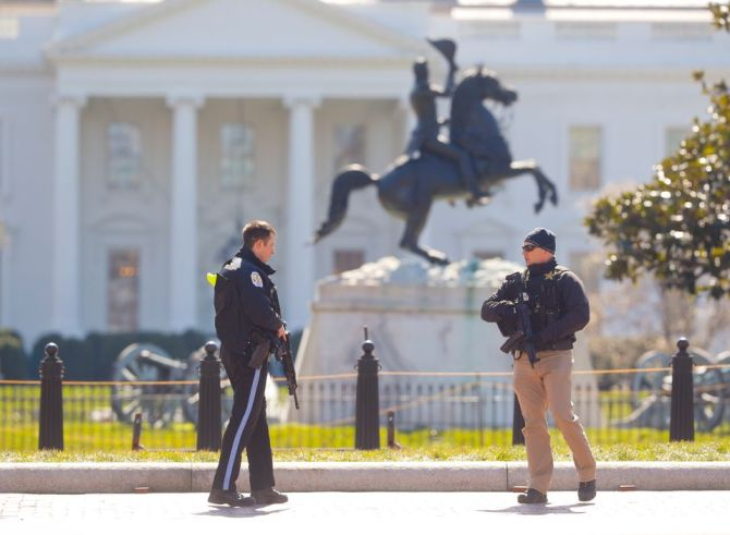 Law enforcement officers at Lafayette Park across from the White House in Washington, close the area to pedestrian traffic, Saturday, March 3, 2018. A man apparently shot himself along the north fence of the White House midday, according to the Secret Service, which also said he was being treated for the wound. (AP Photo/Pablo Martinez Monsivais)