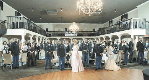 The audience stands at attention during the posting of colors, national anthem and invocation for JSU Army ROTC's 49th Annual Spring Gala. The event was held in the Old Capitol Inn in downtown Jackson.