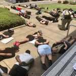 Protestors lie on ground at Jackson Police Department.   PHOTO BY JAY JOHNSON